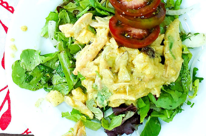 Chicken salad with curry and hot mango chutney on bed of greens