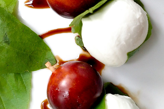 Caprese salad on a stick with heirloom tomatoes and balsamic glaze