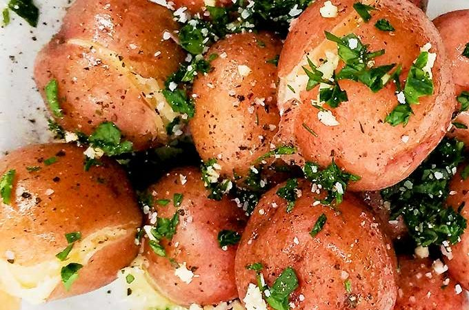 Cook new potatoes with parsley and butter