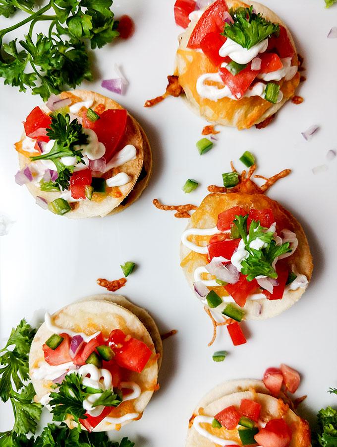 bite size chicken tacos on platter