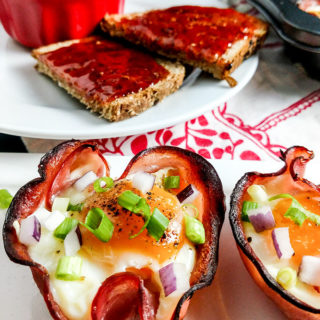 Baked eggs in ham cups on platter