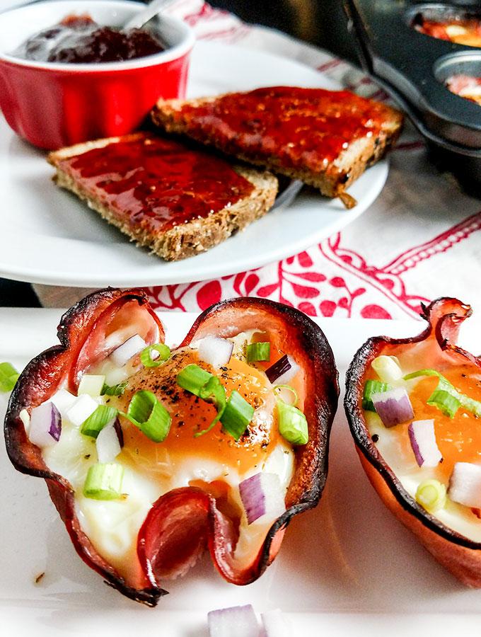 Baked eggs in ham cups on platter
