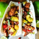 Blackened Fish Tacos with mango salsa in tortillas
